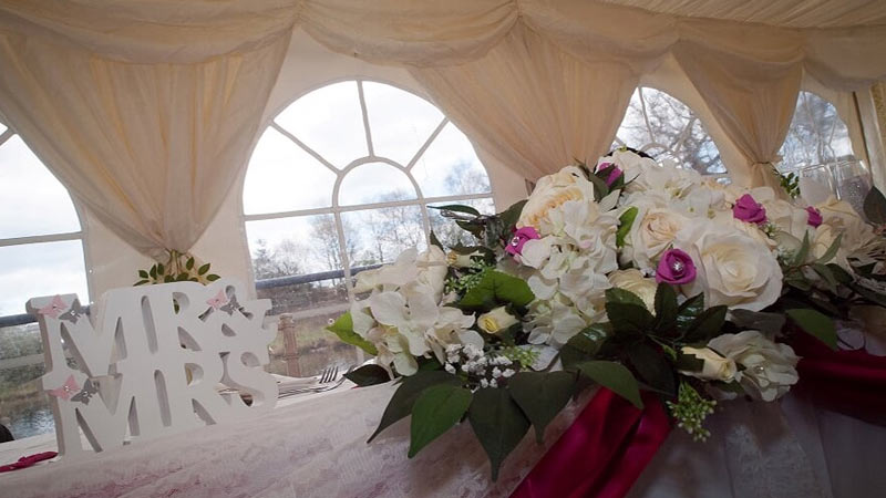 Floral Arrangement near arched windows
